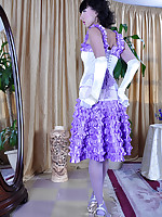 Dressy hottie strips to her retro style white garter belt and lilac nylons
