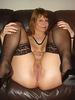 Busty British amateur flashing her tits and stockings