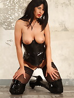 Latex corset and black stockings on Desyra Noir