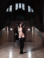 Black haired Desyra in her latex boots