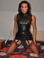 Jane is hiding a big sex toy between her nylon covered legs and it looks fucking good.