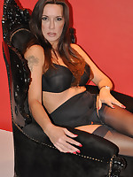 Sultry Jane is dressed all in black and sitting on her throne