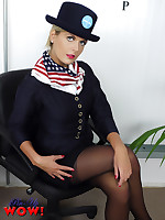 Naughty Air Hostess Victoria in sexy satin pink underwear, suspenders and stockings gives you saucy in-flight treat