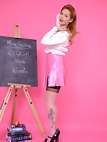 Strict teacher Elle Richie in black stocking stripteases to get a students attention