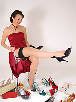 Irresistible Rachael Boden in black corset and stockings takes you shoe shopping. You won't be disappointed!